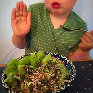 Wheatgrass overnight oatmeal,kiwi, pumpkin seeds, sesame seeds, linseed, chia seed