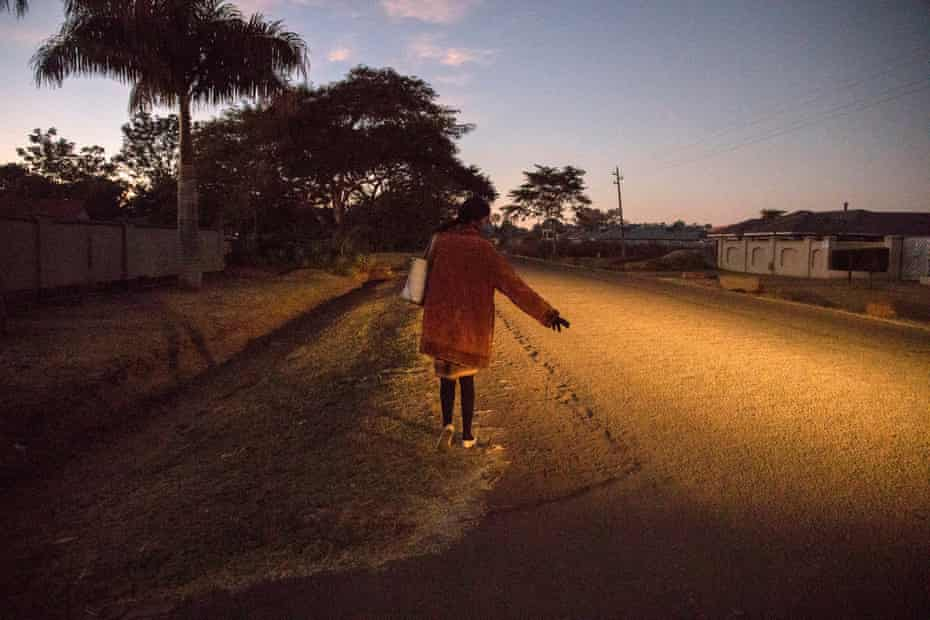 Sandra Chikore hitchhiking early in the morning in Harare