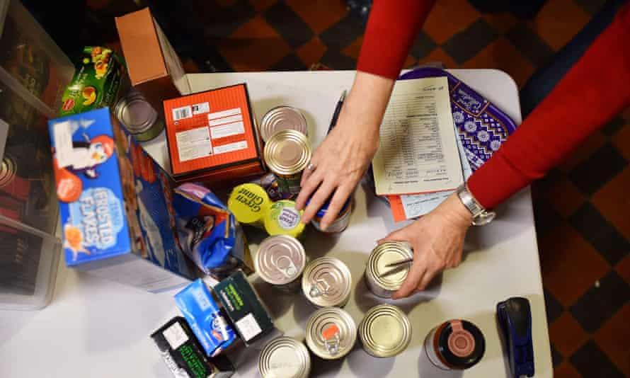 A volunteer sorts items at a food bank in west London