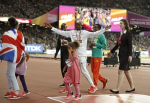 Mo Farah leaves the London Stadium with his children after being presented with his silver medal.