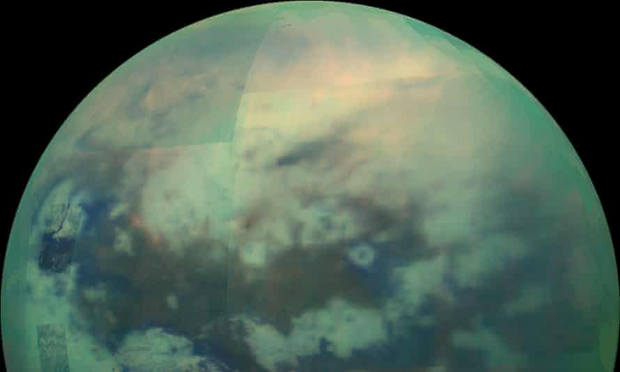 This Nov. 13, 2015 composite image made available by NASA shows an infrared view of Saturn's moon, Titan, as seen by the Cassini spacecraft. The near-infrared wavelengths in this image allow the cameras to penetrate the haze and reveal the moon's surface. (NASA/JPL/ESA/Italian Space Agency via AP)