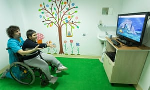 A patient undergoes physical therapy with a game developed by Mira Rehab.