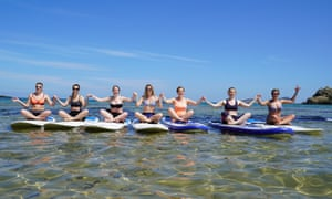 SUP yoga classes take place in the sea