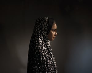 Batool al-Masri, 14, at her house in Beit Hanoun, northern Gaza Strip. On 10 May, in a field near their home, Batool carried her cousin Yazan, a toddler, aged two. 'Twenty-four hours a day she was spoiling him,' says Batool's father, Mohammed Atallah al-Masri. Then, an explosion. It's not clear whether the rocket was fired by Israel or Hamas. But in an instant, eight people died, including six children. Yazan died in front of Batool. She tried to save him, ignoring injuries to her legs and pelvis