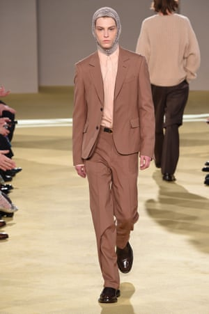"""Salvatore FerragamoCreative director Paul Andrew asked the question """"In this first Ferragamo show of the new decade I want to use the language of fashion to ask: what does masculinity look like in 2020?"""" He answered it with a collection that focused on six male archetypes, Businessman, Biker, Racing Driver, Sailor, Soldier and Surfer. By scrambling their wardrobes and switching up the fabrics the 2020 Ferragamo man emerged in fluid tailored wool. Bermuda shorts paired with biker boots and a blazer, while light weight suiting was paired with a fine knit balaclava"""