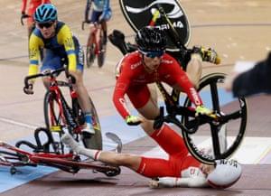 Xiaofei Wang of China (top) crashes into Poland's Daria Pikulik during the women's madison