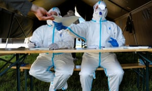 Medical members of the Austrian army sit in a tent in a military barrack during the coronavirus outbreak in Vienna, Austria 4 May 2020.