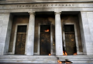 Fire caused by petrol bombs thrown by youths is seen at the building of Greece's central bank in central Athens.