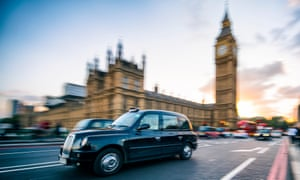 A black cab on Westminster Bridge in London.