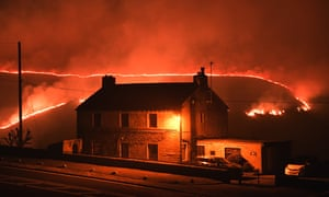 A wildfire burns on Saddleworth Moor on 26 February 2019, the country's hottest winter day on record.