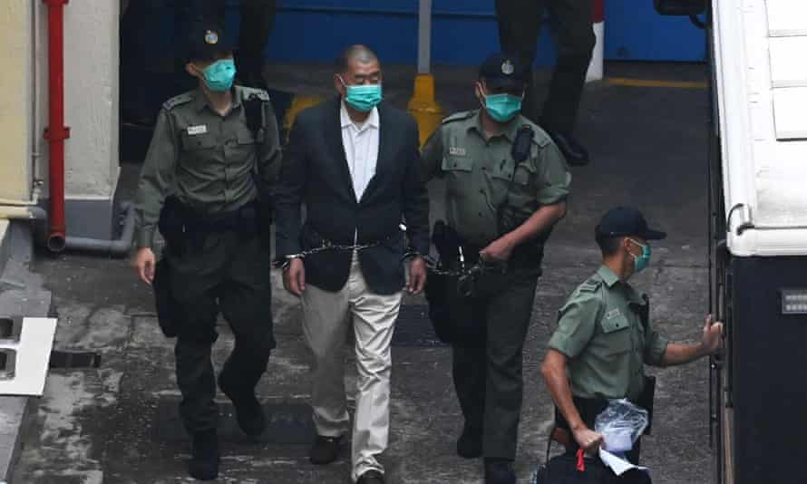 Jimmy Lai in handcuffs on his way to court on Saturday.