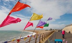 Flags flutter on Chesil Beach, Portland, as Storm Hannah blows in.