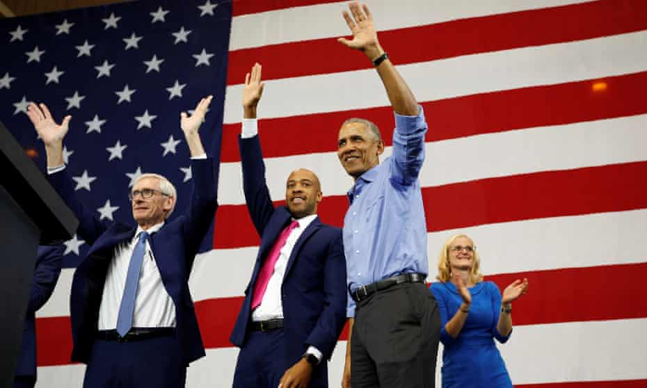 Barack Obama waves to the crowd during a rally for Wisconsin Democratic candidates in Milwaukee in October 2018.