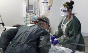 Nurses care for a patient in an intensive care ward in Frimley Park hospital in Surrey.