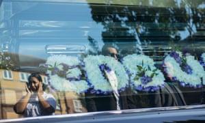 Mourners attend a vigil preceding the funeral of Edson Da Costa in east London.