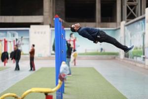 Sun Rongchun, 57, exercises in Shenyang, north-east China
