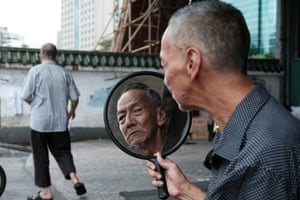 Uncle Chen was living under a bridge in Guangzhou, China. This photo is from the moment he was able to see his new look. Shortly after meeting Uncle Chen, I was contacted by friends from China that he was recently killed in a car accident.