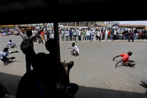 Spectators cheers disabled footballers at a match played at the Taxi Station, High street, Accra, Ghana