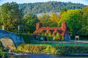 Autumn sets in on the banks of the River Conwy in Llanrwst, Wales