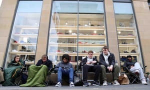 Trainer fans queue outside the End store in Newcastle. Shoppers plan to stay there until Kanye's new shoes are released.