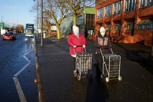 Residents and shoppers in Longsight, south Manchester