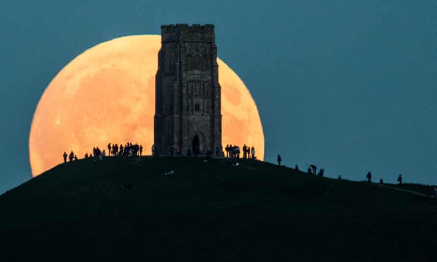 A supermoon rising over Glastonbury Tor