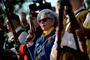 Girona, Spain: A woman holds a blunderbuss in Sant Julià de Ramis during a ceremony to commemorate the one-year anniversary of the Catalan independence referendum