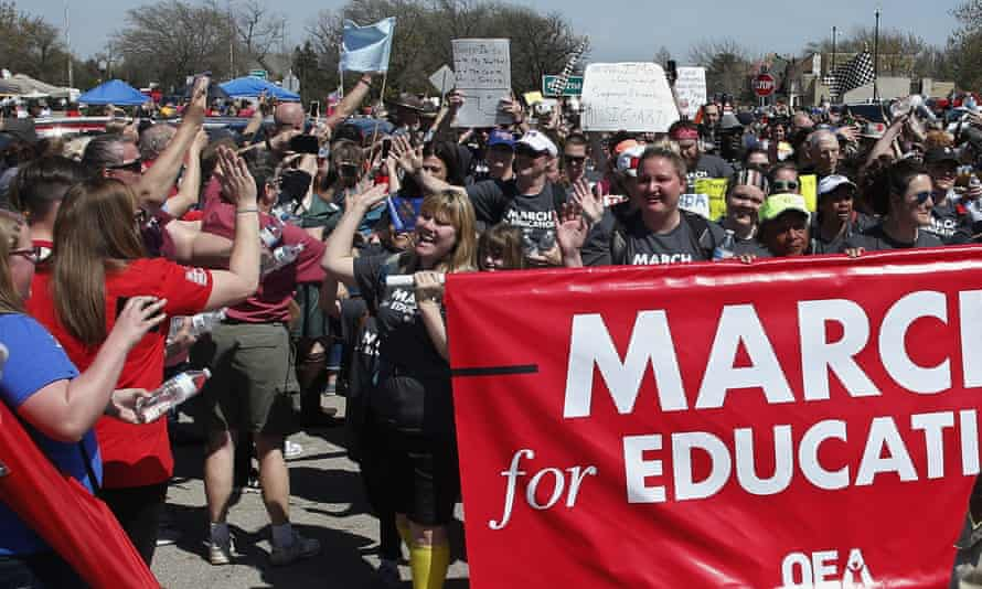Marchers are greeted at the state Capitol after marching 110 miles from Tulsa as protests continue over school funding, in Oklahoma City, on 10 April.