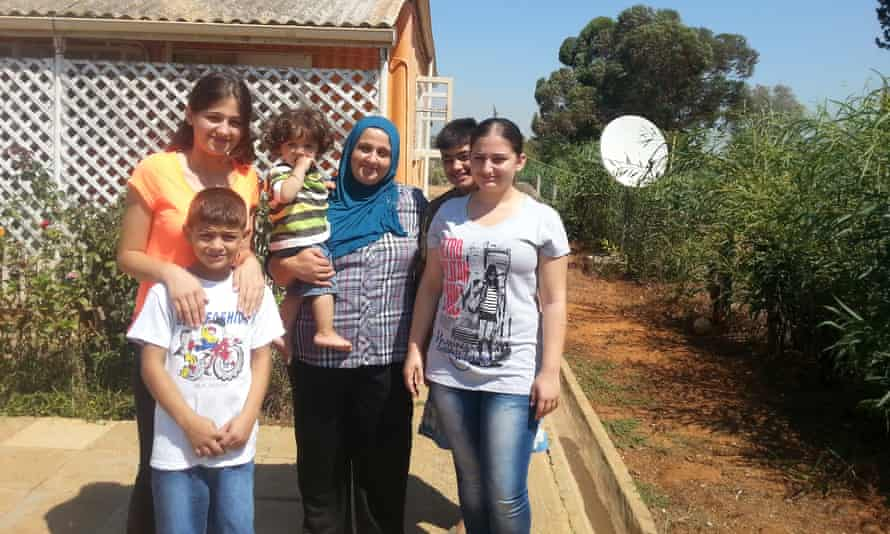 Layali Ibrahim (right) with her brothers, sister and mother, Avin, who is holding 15-month-old Omar