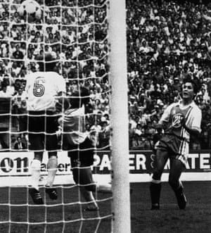 Rabah Madjer (right) scores Algeria's first goal against West Germany.