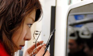 Is it acceptable to do your makeup on the subway in your city? Let us know.