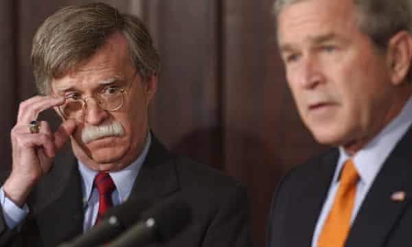 John Bolton listens to George W Bush at the White House in 2005.