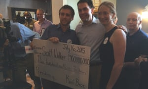 Scott Walker presented with a fake check for $900m.