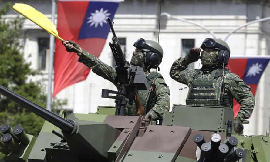 Taiwanese soldiers salute during a national day parade at which president Tsai Ing-wen said the island would not bow to Chinese pressure.