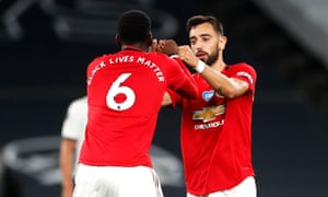 Bruno Fernandes celebrates scoring his side's goal with Paul Pogba