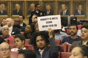 Rudolf Jovero of Las Vegas holds a sign inside council chambers during a protest against the city council's ban in November.