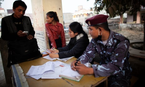 Pema, who was trafficked, sits at a desk