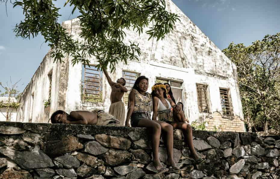 Young Macuxi people wait to perform at the assembly of the indigenous council, which represents the majority of those living in the Raposa reserve.