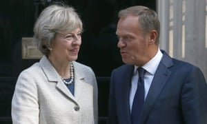 Theresa May greets Donald Tusk outside 10 Downing Street.