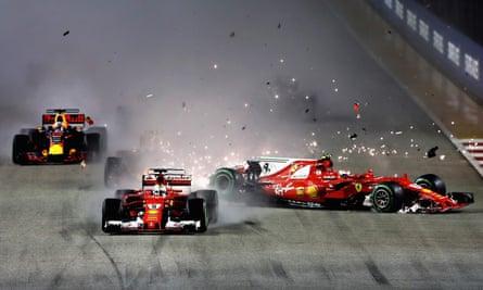Sebastian Vettel (No5) collides with Ferrari team-mate Kimi Raikkonen on the opening lap.