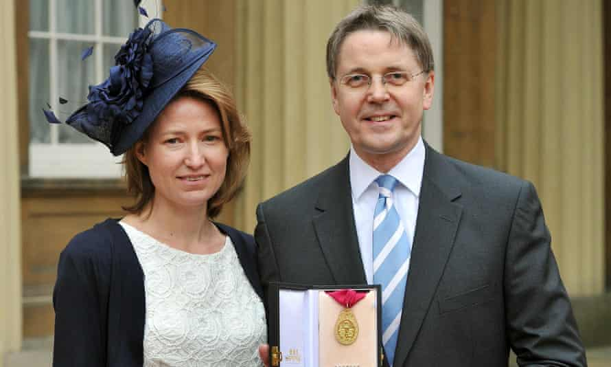 Sir Jeremy Heywood with his wife, Suzanne, after his investiture ceremony