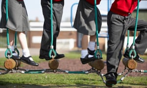Young schoolchildren playing on a rope ladder