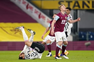 Manchester United's Edinson Cavani goes down after a challenge by Burnley's Ben Mee.