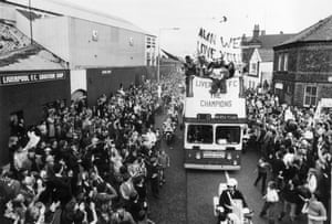 The party continues on the streets of Liverpool as an open-top bus tours through the city