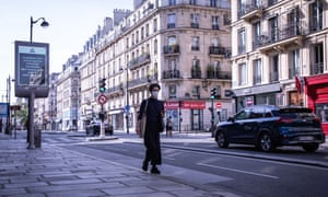 A man walks along an almost deserted street in Paris on Sunday during the country's lockdown.