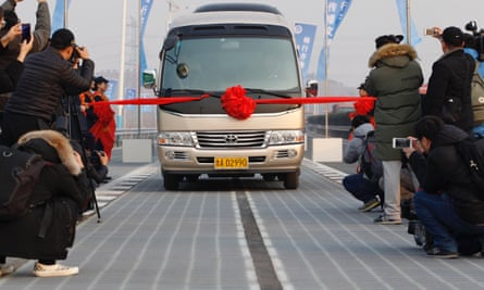 The first vehicle is driven on the photovoltaic road in Jinan, China. Only days after it was opened, thieves have stolen some of the technology.