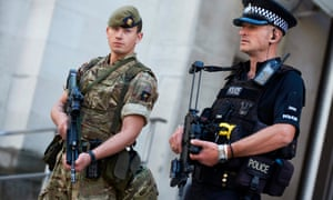 A British army soldier and a police officer outside the Ministry of Defence in central London