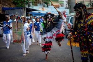 Rio de Janeiro, Brazil: revellers participate in the traditional celebration Folia de Reis Penitentes do Santa Marta
