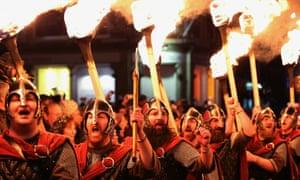 A torchlight procession of men dressed as Vikings in Edinburgh