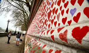 Red hearts representing the 150,000 UK victims who have died with the coronavirus, painted on the National Covid Memorial Wall, opposite the Houses of Parliament in London.